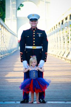 So cute! Marine and his daughter (I think) dressed in their finest dress blues.