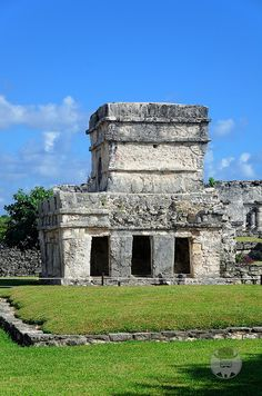 "Tulum Mayan ruins, Yucatan, Mexico - ""Temple of the Frescos"" was used as an observatory for tracking the movements of the sun. Niched figurines of the Maya ""diving god"" or Venus deity decorate the facade of the temple."