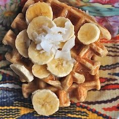 Whole Wheat Coconut Waffles..smothered in bananas     http://thecornerkitchen.blogspot.com/2012/03/whole-wheat-coconut-waffles.html