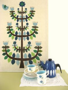 That would be an Alexander Girard tapestry. So lovely. Especially paired with a Cathrinehom tea pot.