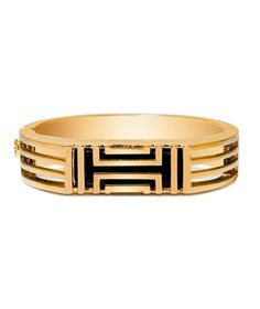 Tory Burch for Fitbit Metal Hinged Bracelet: Track your activity without cramping your style: This pretty gold bangle not only makes a sophisticated wardrobe staple, it also discreetly holds a Fitbit monitor.