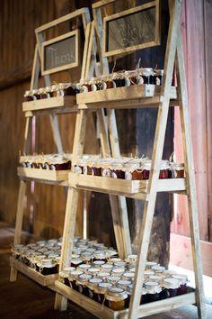 Jam favors from a barn wedding - great ladder display! #wedding