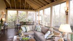 Wide-plank flooring in this screened porch