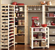 Pantry with pull-out KitchenAid Stand Mixer cart (can see putting baking ingredients and/or tools on the shelves of the cart)