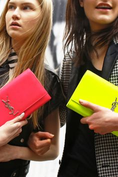 Get in touch with your neon side with Saint Laurent's spring clutches! #tb