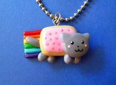 Nyan Cat Charm Necklace on Etsy. Seller is MadAristocrat. $16.00 Disclaimer: While I do have a mild obsession with the Poptart Kitty, I do not necessarily want all or any of the items I'm pinning here.