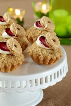 Mini Berry Crumb Cakes. Top with a raspberry-filled cookie for a not-so-garden-variety delight.