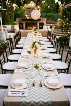 Chevron table runner & the perfect ambiance for an evening outside.