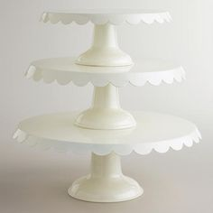 One of my favorite discoveries at WorldMarket.com: Ivory Scalloped Metal Pedestals