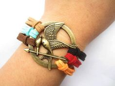 I found 'Mockingjay inspired Bracelet---antique bronze The hunger game style pendant & colorful rope chain' on Wish, check it out!