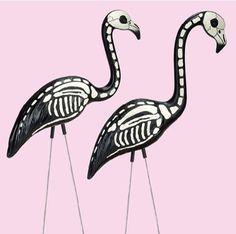 "DIY Halloween Yard Decoration: Re-purpose pink garage sale flamingos into creepy black and white ""Skeleton Flamingos"""