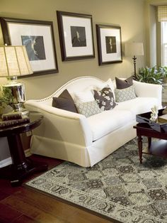 Originating in the late 18th century, this Chippendale-style sofa combines a classic look with timeless details and comfort. The sofa is named for its serpentine back that gracefully flows into high rolled arms. In early versions, lush, elaborate upholstery, tight seating and colonial claw and ball feet were the defining features, as well as the distinctive back and arms. This early style was often found in traditional, Victorian settings. Now, it has become a common furnishing in American