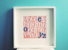 this is so cute! how to make a frame with letters of the alphabet. the non-white ones are the ones in the child's name. love this.