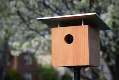 Build your own MCM bird house! This easy project adds a sweet touch of mid-century to your yard.