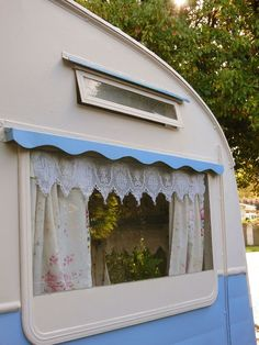 Like the exterior blue 'valance' above the window - think this could double as awning anchor.