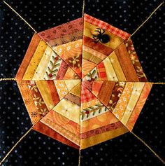 cool Halloween spider web themed quilt block form Patchwork Pottery - the spider is a combination of a button and embroidery