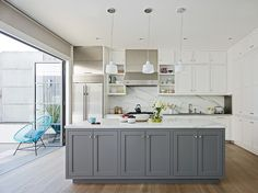 indoor outdoor living, grey kitchens, kitchen benches, white cabinets grey island, open kitchens, kitchen layouts, white kitchens