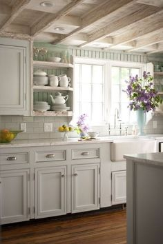 Clean, country kitchen - like the subway tile and then bead board..