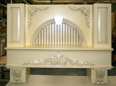 Another custom hood mantel, with lots of flair! Our Creme Brule finish gives it a warm, elegant look...
