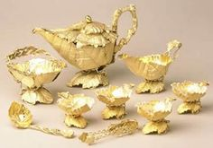 Teapot, milk jug, sugar basin, sugar tongs, ladle and four small dishes, silver-gilt, made by William Smith of Liverpool. 1870-71. http://www.liverpoolmuseums.org.uk/walker/collections/craftdesign/design/naturalism/teaservice.aspx