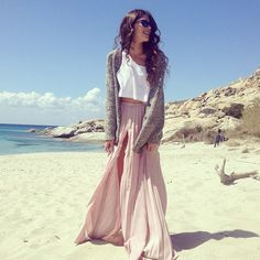 cropped white top, pale pink maxi skirt, and a cute sweater.