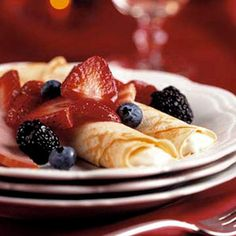 Topped with fresh fruit and wrapped around a rich cream cheese filling, these thin pancakes are great for a special-occasion breakfast or brunch.