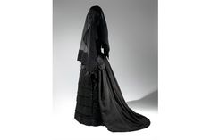 Mourning Ensemble, 1870-1872, Black silk crape, black mousseline. Death Becomes Her: A Century of Mourning Attire October 21, 2014-February 1, 2015 (Metropolitan Museum of Art, New York)