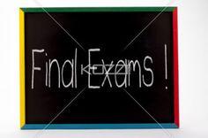 final exams written on slate board. - Final exams written on small students slate board.