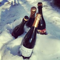Backyard snow has many uses, not the least of which is chilling champagne. One tomato, two tomato