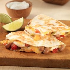 Chicken and Bean Quesadillas... Spice your weeknight meal up with these quesadillas filled with chicken strips, pinto beans, zesty tomatoes and cheese in just 30 minutes.