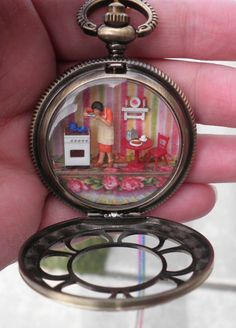 Mother's Day dollhouse miniature scene in a pocket watch with tiny cook tasting her food in a itty bitty kitchen: by Sheila A. Nielson
