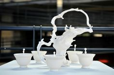 Check out Johnson Tsang's incredible ceramic sculptures where human forms seem to move effortlessly through bowls, cups and plates.  http://www.thisiscolossal.com/2013/12/living-clay-johnson-tsang/