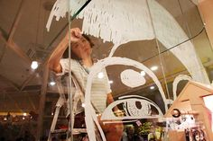 This is CelesteAnning drawing live on our window glass display during our re-opening day. (August 2014)