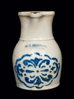 "Price Realized: $ 2,530.00 Very Rare Half-Gallon Stoneware Pitcher with Stenciled Cobalt Decoration, Stamped ""F.H. COWDEN / HARRISBURG, PA,"" circa 1880, finely-potted pitcher with ovoid body and tall flaring collar, the front decorated with a large stenciled geometric design below the F.H. Cowden maker's mark. Rare form and size. Provenance: From a thirty-five-year North Carolina collection. Small chip on left side of rim. 3"" crack to right side of rim. S"