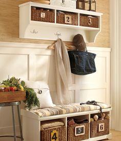 or bench with storage baskets or boxes underneath for the entry