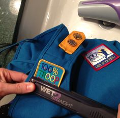 Use a flat iron to quickly add Daisy or Girl Scout badges - heat to 350 and hold for 20 sec over each area of the badge.