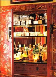 Alessandra Branca converted a liquor cabinet into a working bar by adding a mirror on the back, glass shelves and lights.  I love this!