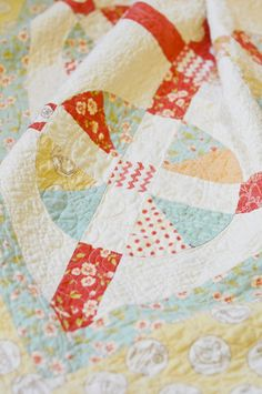 "Fig Tree Quilts, the pattern is called ""Sunwashed""."