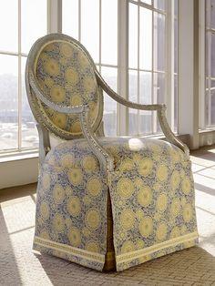 Long flat paneled skirt on upholstered chair