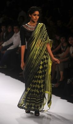 A model showcases a creation by designer Archana Kochhar on the final day of Lakme Fashion Week (LFW) winter/festive 2012 in Mumbai on August 7, 2012