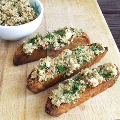 Tasty bruchetta with feta, green olives and tahini. Perfect for parties! | giverecipe.com | #partyfood #party #olive #bruchetta