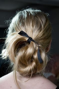 A simple black ribbon glams up a messy twist