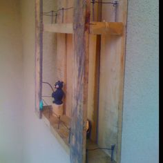 Pallet shelf with nails and wire DIY