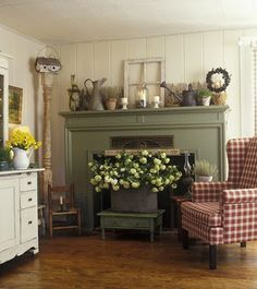 Love the huge basket of flowers in front of the fireplace for the feeling of spring!