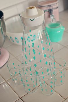Vintage Pyrex turquoise starburst and diamond juice carafe with matching glasses. LOVE!! :)
