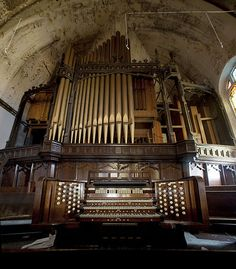 Pipe organ left behind in the abandoned Woodward Presbyterian Church Detroit MI.