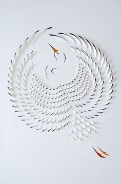 Australian paper artist Lisa Rodden cuts, slices, and folds thick layers of white paper on top of acrylic painting .