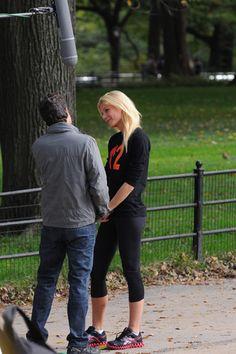 Gwyneth Paltrow holding hands with Mark Ruffalo on movie set