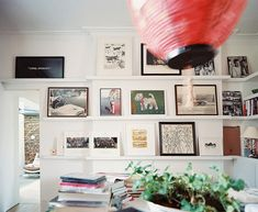 Rearranging your favorite prints is easy when they're floating on built-in shelves.