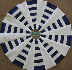 The Dresden Plate quilt requires a lot of applique due to the circular pattern. Once finished, this quilt is colorful and beautiful. Make it from scraps of material or make a themed pattern quilt. Make the edges of the wedges pointed, rounded or use both ideas to make your Dresden Plate quilt block.